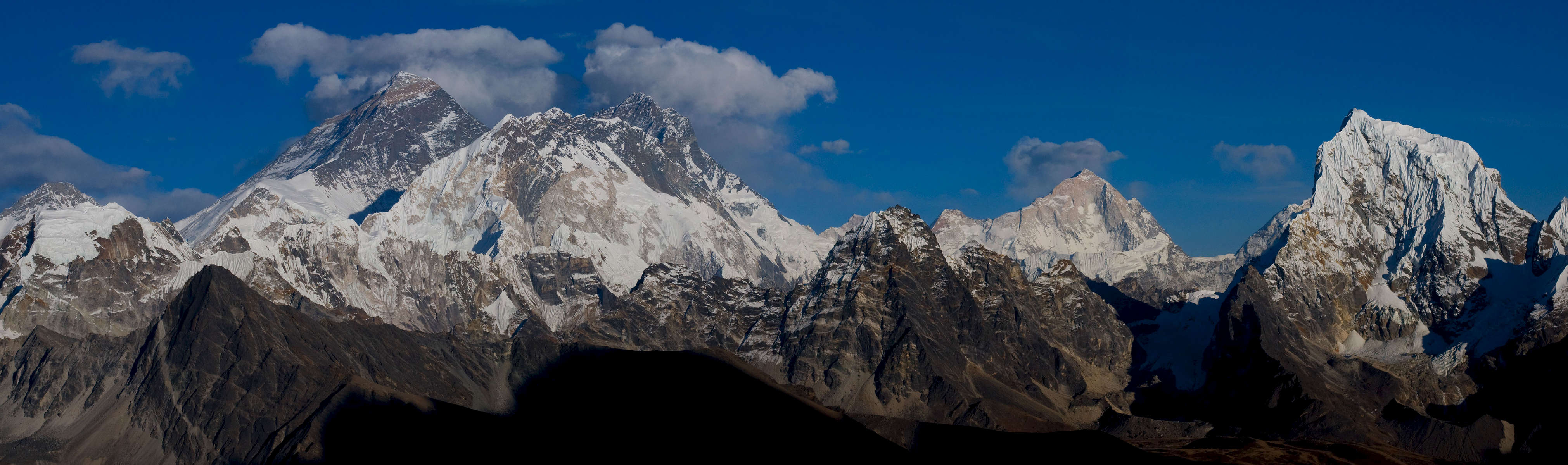 Everest, Nuptse, Lhotse, Makalu & Cholatse seen late in the afternoon from this 5345m pass. Taken mid December when the air is crystal clear, the detail is incredible.Nikon D300, 50mm