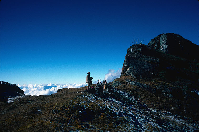 The unmistakable silhouette of Rex {quote}Rexatious{quote} Munro standing on this col with our porters during our 45 day epic trek across eastern Nepal in November 1988Canon A1, 28mm, Kodachrome 64