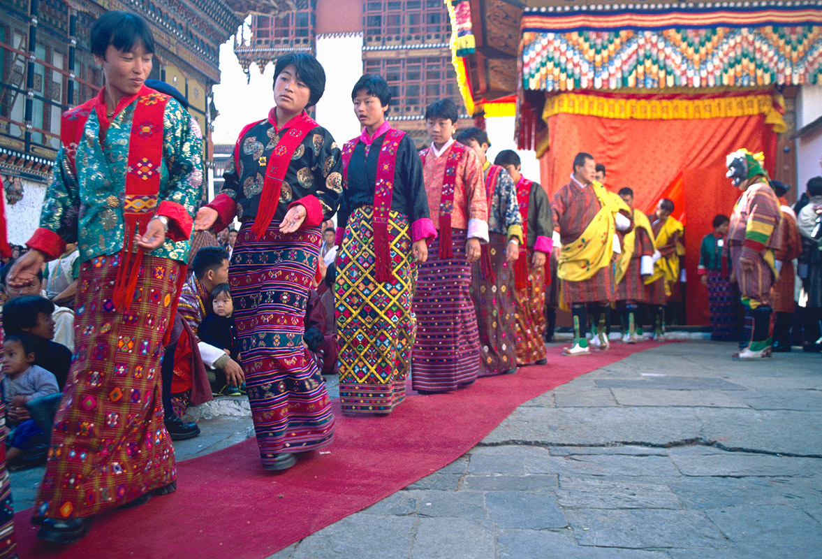 Women of the royal household entering the courtyard at the start of the annual tsechuNikon FM2, 24mm, Fuji Velvia