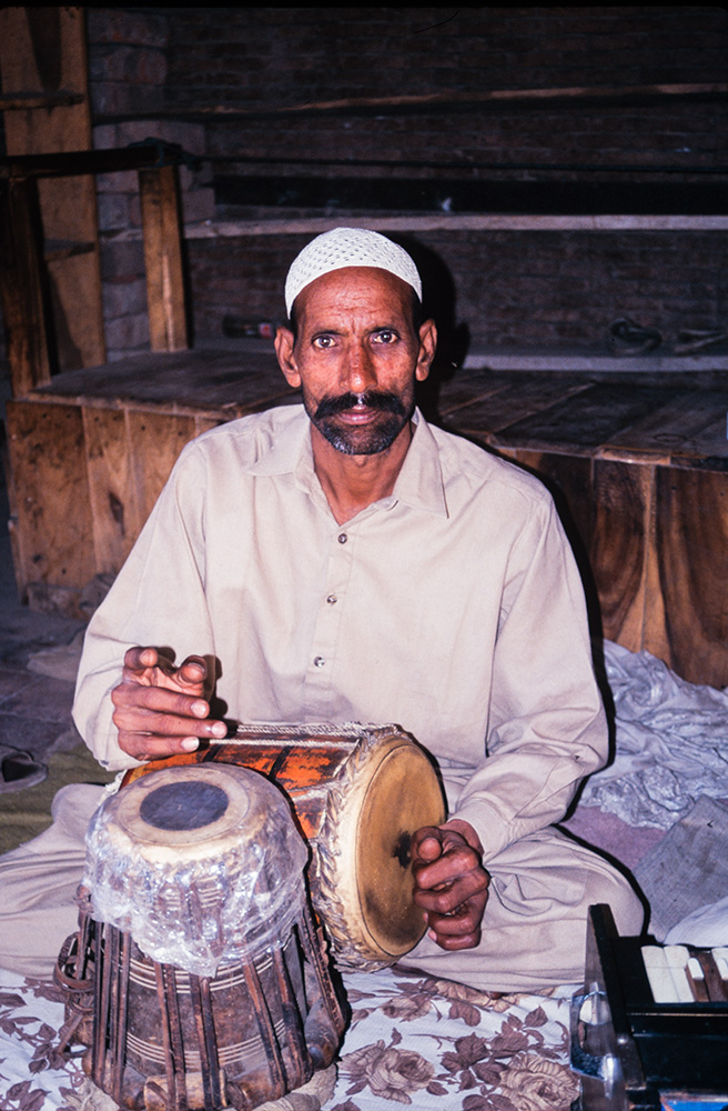 Qawwali tabla player at the mausoleum of Sufi saint Shah Rukn-i-'Alam