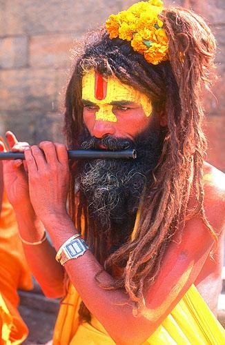 A Hundu saddhu plays a hypnotic lament on his flute at Pashupatinath, KathmanduNikon FM2, 50mm, Fuji Velvia