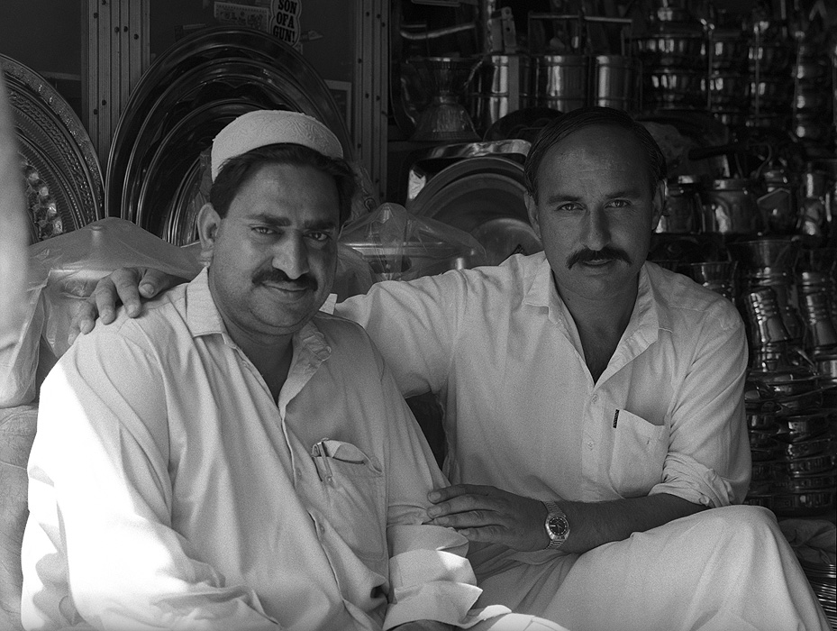 Shopkeepers in Saidu Sharif. Two men sitting in their kitchen-ware shop in the capital of Swat, NWFP, Pakistan