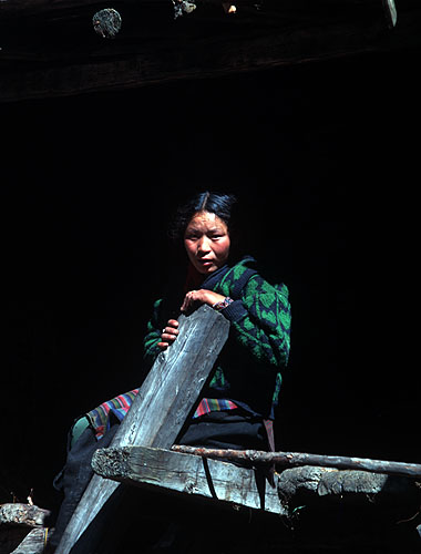 A woman on the porch of her house in the largest village in Nupri, north of ManasluBronica ETRSi, Fuji Velvia, 150mm