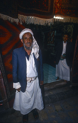 A carpet seller in the main suqNikon F5, 17-35mm, Fuji Velvia 100