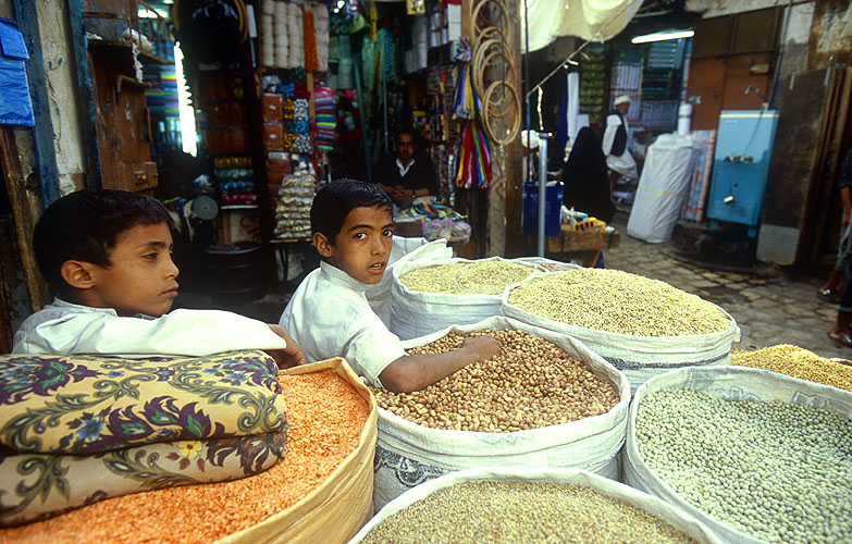 Boys selling pulses in the main SuqNikon F5, 17-35mm, Fuji Velvia 100