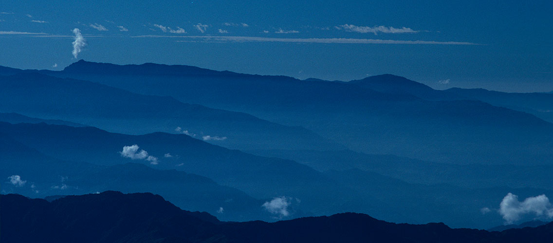 The ridges and valleys of the Himalayan foothills below, still in shadow as dawn breaksCanon A1, 135mm, Kodachrome 64