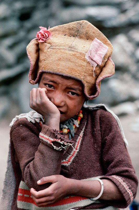 A young Zanskari boy wearing the distinctive yellow cap of the Gelukpa Buddhist sectCanon A1, 50mm, Kodachrome 64