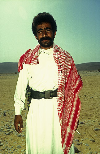 A Bedouin man in the desert near this once magnificent cityNikon F5, 17-35mm, Fuji Velvia