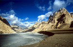 Mention the name {quote}Shaksgam{quote} to anyone familiar with the Karakoram, and their eyes will glaze over as a  misty, distant  reverie takes hold. The mighty river that flows in this valley rises in Ladakh, skirts hard under the northern flanks of the highest Karakoram peaks and finally debouches onto the searing salt flats of the Tarim Basin where it evaporates completely. This shot is of the valley at Karchin Bulak, where the trail from the Afghil Pass enters the valley from the north.Nikon FM2, 24mm, Fuji Velvia
