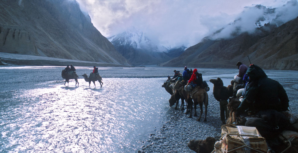 An expedition making its way along the Shaksgam valley towards K2. Due to the braided, ever shifting course of the river, crossings are frequent - and frequently hazardous.Nikon FM2, 24mm, Fuji Velvia
