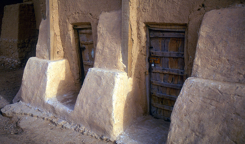 Detail of typical houses,  showing the main doorways and 2m thick bases of the mud-brick wallsNikon F5, 17-35mm, Fuji Velvia