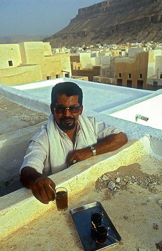 Yemeni hospitality! It never ceases to amaze me that in spite of peoples' perceptions of the aggressive foreign policies of our governments, we are still universally greeted with courtesy and genuine hospitality. To my mind, this is a true measure of civilization. This man invited us up to see the city from the roof of his house.Nikon F5, 17-35mm, Fuji Velvia 100