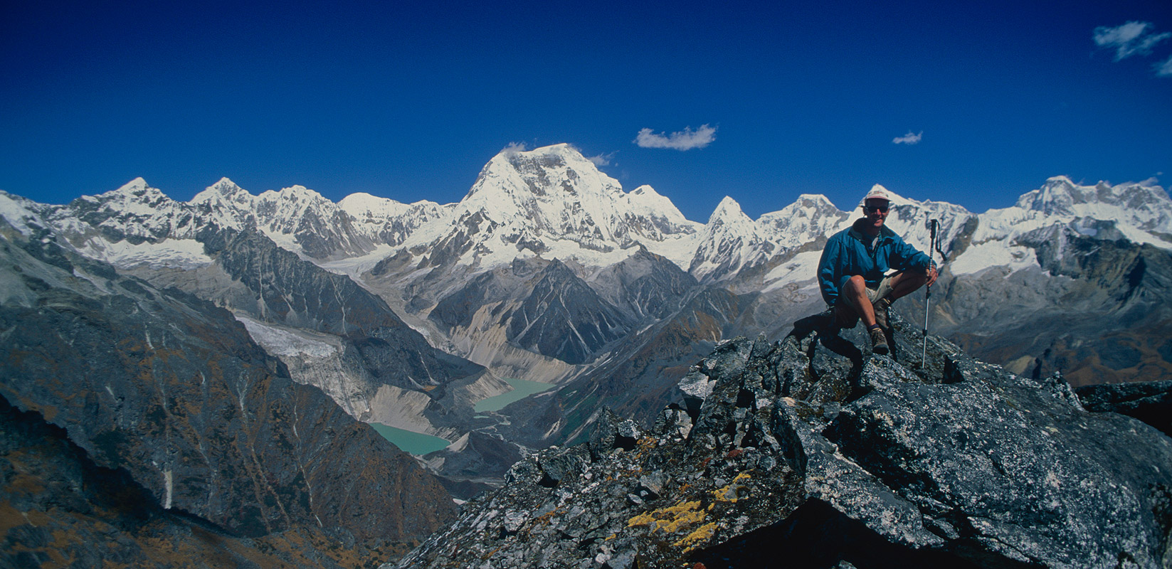 Yours truly on the crest of a ridge above the pass, with Jejekangphu Kang etc beyond.Nikon FM2, 28mm, Fuji Velvia
