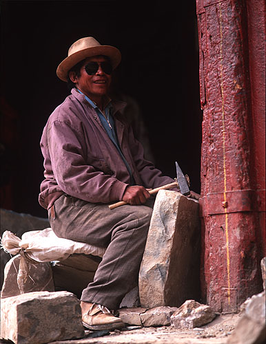 A stone mason working on renovations at this huge monastic complex in Shigatse (Xigatse)Bronica ETRSi, 75mm, Fuji Velvia