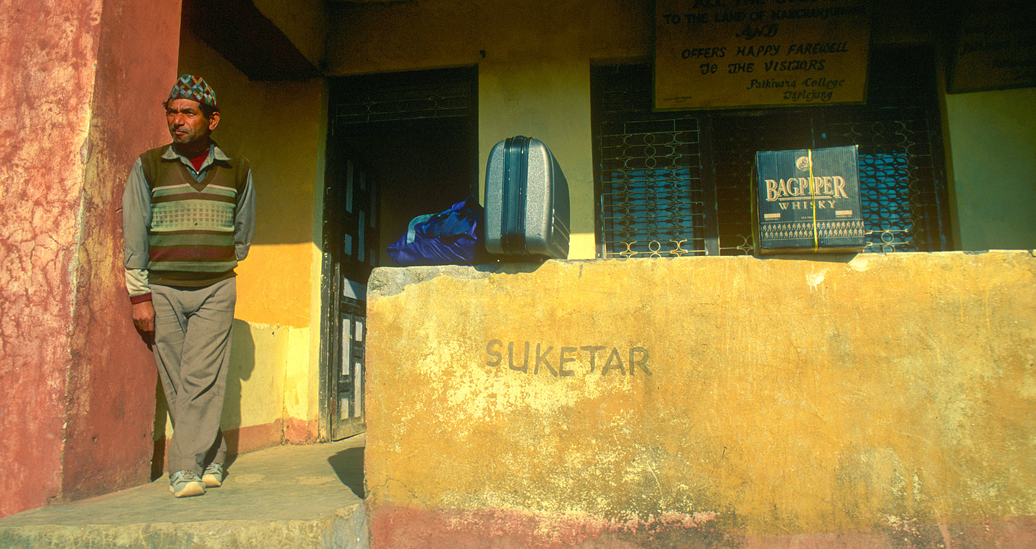 Waiting for the daily flight to Biratnagar. This is the old departure gate at this tiny airfield atop an airy ridge at Taplejung.Nikon FM2, 24mm, Fuji Velvia