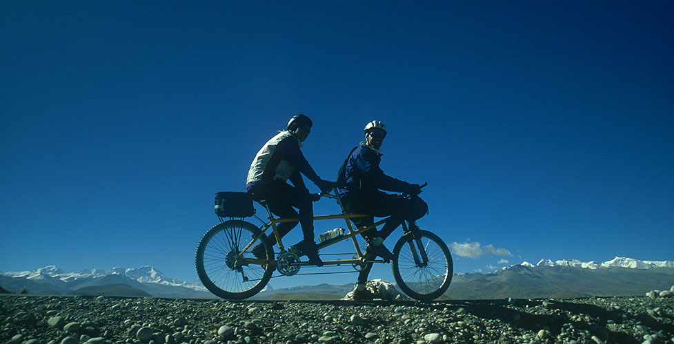 Ken and Cindy Dowling were the first people ever to ride a tandem all the way to Everest base-camp. This photograph taken looking towards the Nepal Himalaya from Tingri.Nikon FM2, 24mm, Fuji Velvia