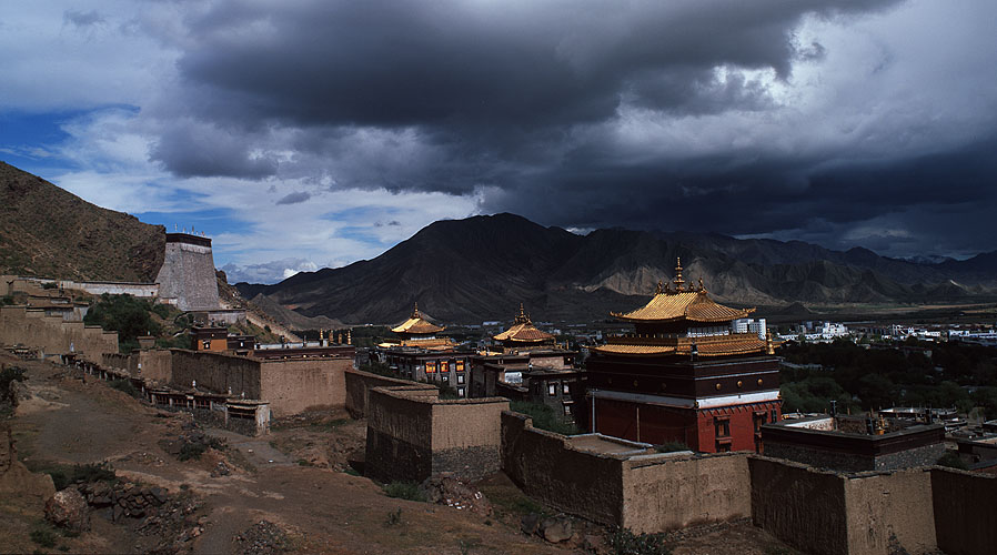 The gilded roofs of this huge monastic complex at Shigatse, under a stormy skyBronica ETRSi, 50mm, Fuji Velvia