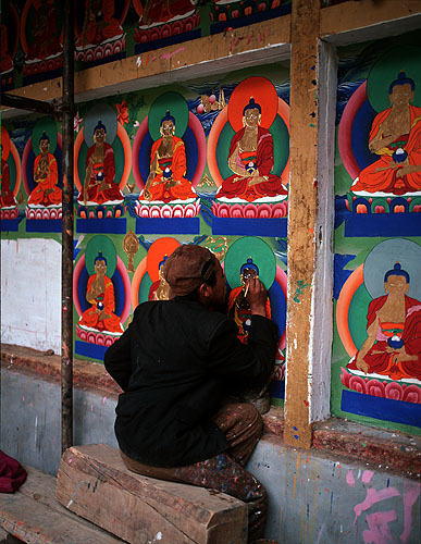 An artist applying gold-leaf to a mural during renovations at the seat of the Panchen Lama in ShigatseBronica ETRSi, 75mm, Fuji Velvia