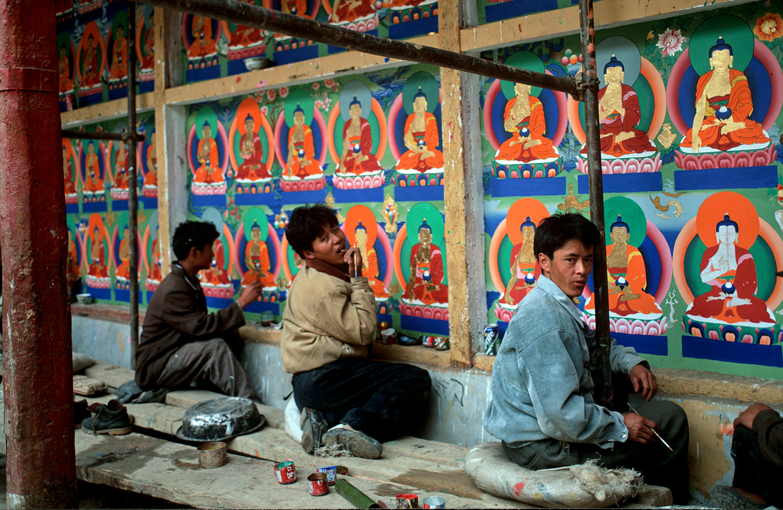 Artists working on a mural during renovations at the seat of the Panchen Lama in Shigatse (Xigatse)Bronica ETRSi, 75mm, Fuji Velvia