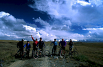 Heli-biking group about to set off on the 48km ride back to Karkara Mountain Base, having been dropped at this pectacular location by helicopter.Nikon FM2, 24mm, Fuji Velvia