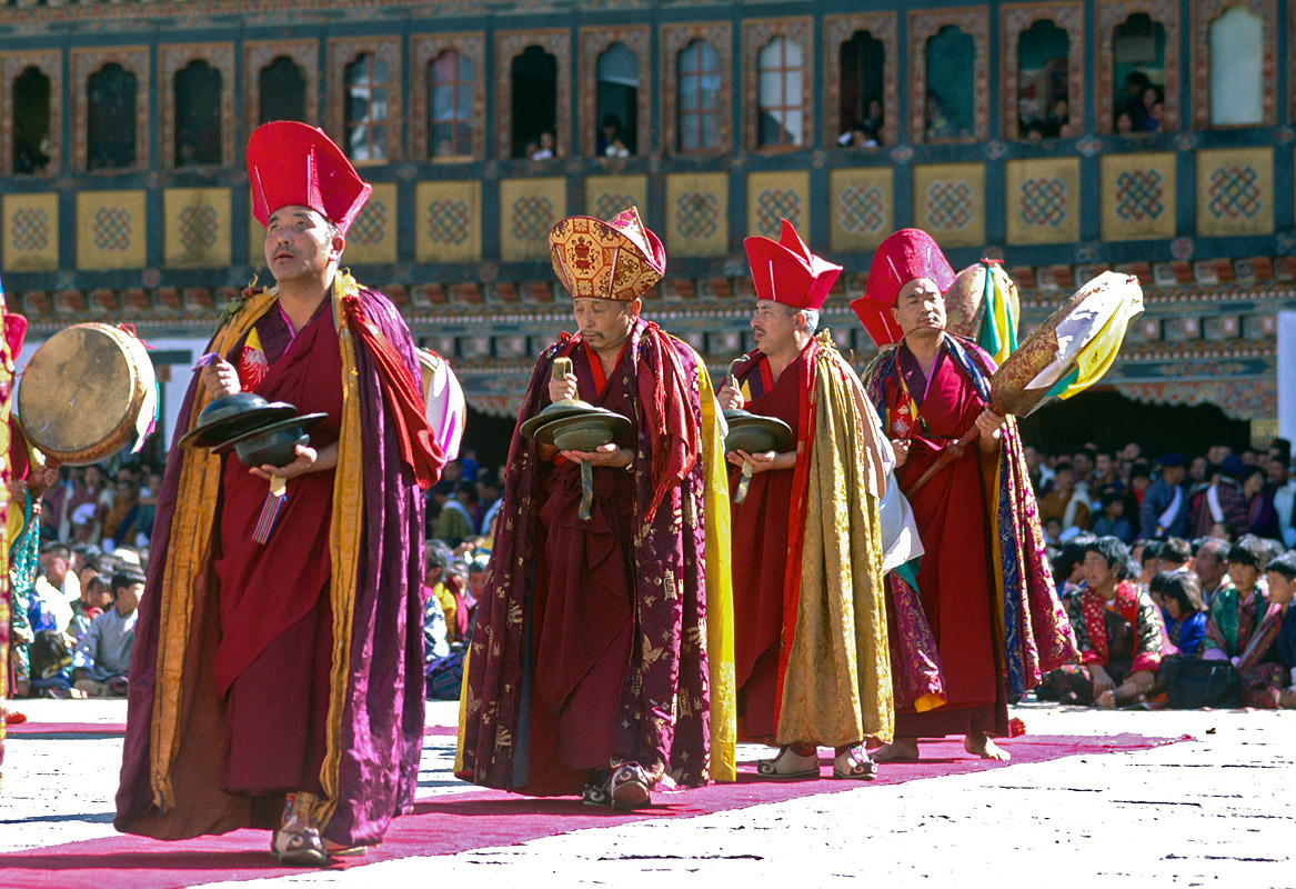 Monks dancing during the annual tsechuNikon FM2, 50mm, Fuji Velvia