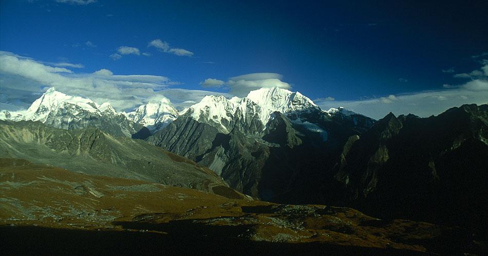 A view east from Tserko Ri (5033m) with Gang Chenpo (6387m) on the right, Langshisa Ri (6310m) and Pemthang Karpo Ri (6830m).Nikon FM2, 24mm, Fuji Velvia