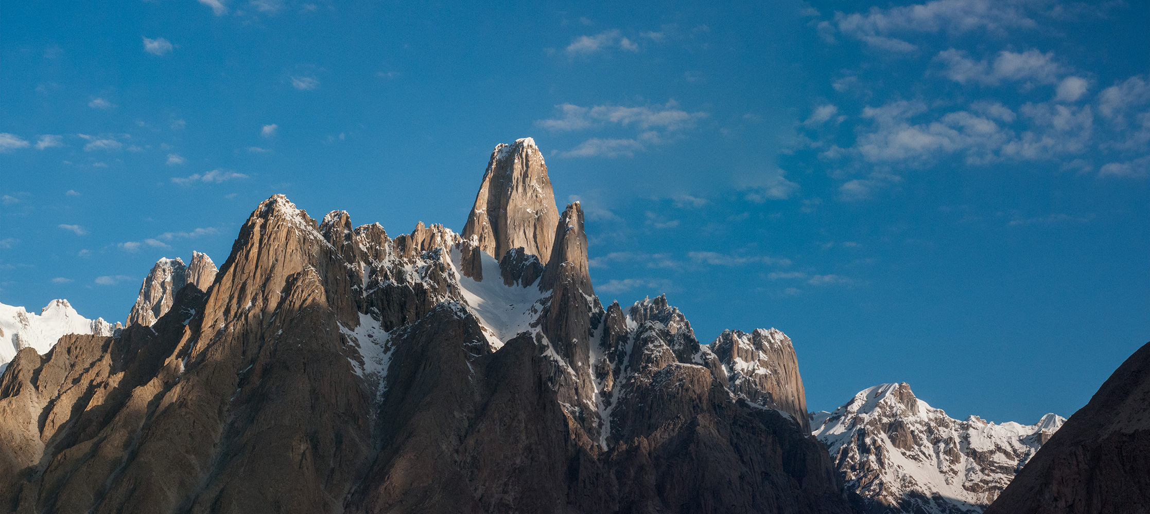 A stitch of two photographs taken in early morning light from Hobutse camp on the Baltoro glacier. Pleased with this one!Nikon D300, 60mm