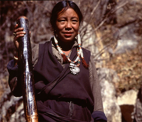 Bhotia means {quote}of Tibetan origin{quote}, and the communities of upper Humla are almost all Tibetan Buddhists. This woman is taking a break from her work pounding millet, a staple in this region.Bronica ETRS, 75mm, Fuji Velvia