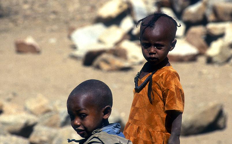 Kids in the town centreNikon F5, 180mm, Fuji Velvia 100