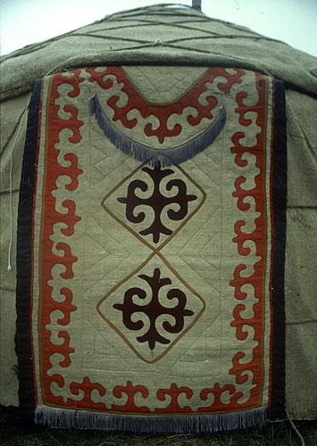 Distinctive Kyrghyz decorations on the felt door of a traditional yurt.Nikon FM2, 50mm, Fuji Velvia