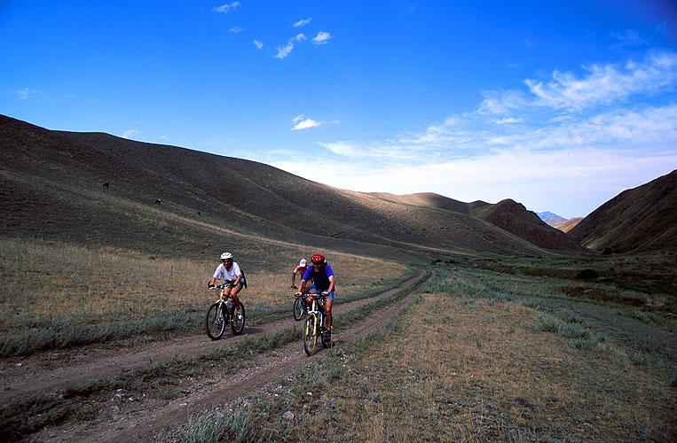 Riding up this lonely valley towards the Ashyk Dala plateau. Tien Shan range.Nikon FM2, 24mm, Fuji Velvia