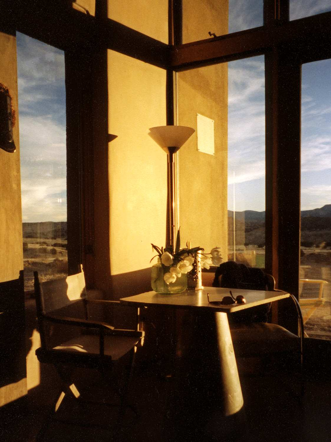 Dining room in winter light, looking out over the valley.