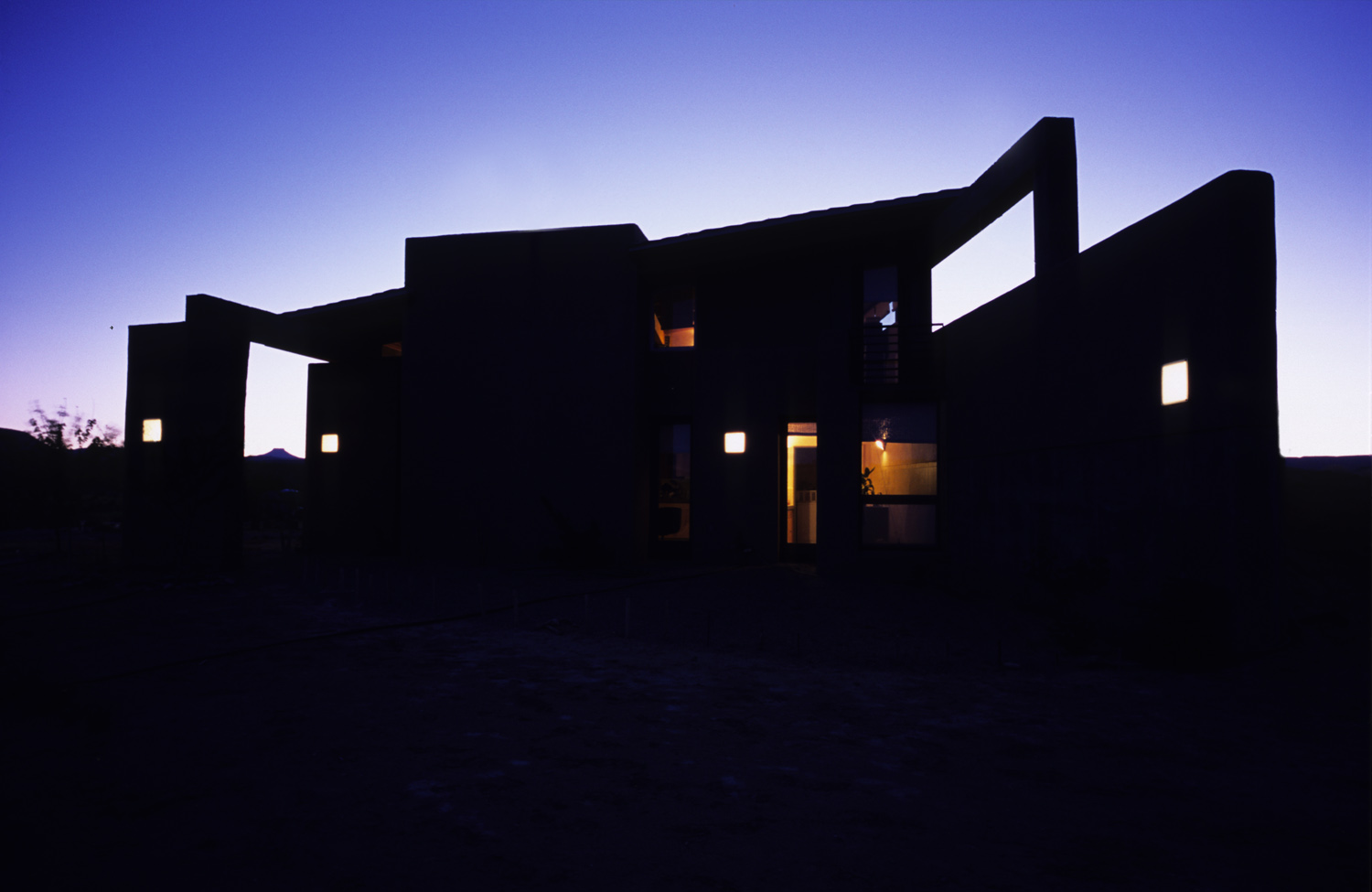 2006 ENERGY & SUSTAINABILITY AWARDAMERICAN INSTITUTE OF ARCHITECTSSAN FRANCISCO CHAPTERAn artist's studio and residence in Abiquiu, New Mexico. High desert, about 6,000 feet above sea level. The program called for a passive solar building consisting of a workshop and dwelling as a first phase, and a residence as a second. The client - an artist whose work bridges a variety of media and contexts - states her predilections in an early letter: {quote}Clearly passive solar, water conservation and other ecological concerns are on my mind, but so are simplicity, function, as well as an interest in incorporating traditional  details, possibly in unexpected ways.{quote}