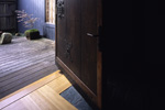 An original Kura door was adapted by inserting it within a steel frame and pivoting it top and bottom at 3 feet / 1 foot.