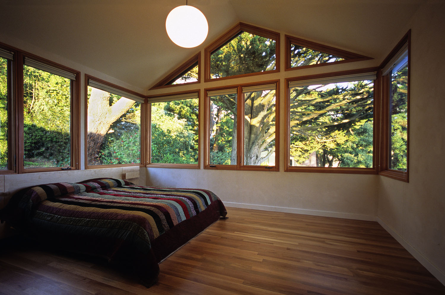 A two-story addition and extensive renovation of a residence in the Berkeley Hills. The bedroom, nestled under a majestic cypress tree, looks out to the backyard, neighboring tile rooftops and a long view of San Francisco Bay.The general contractor was Shigoto Ya, www.shigoto-ya.com