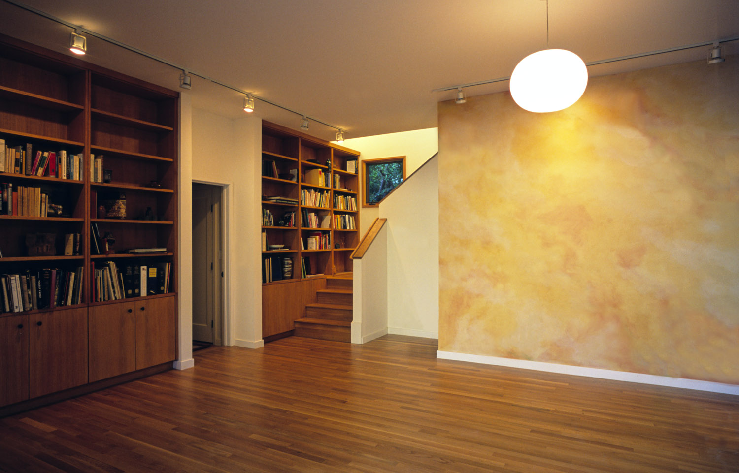 Built-in bookcases and storage line the east and west walls. The library is a multi-purpose room, used for large family gatherings.