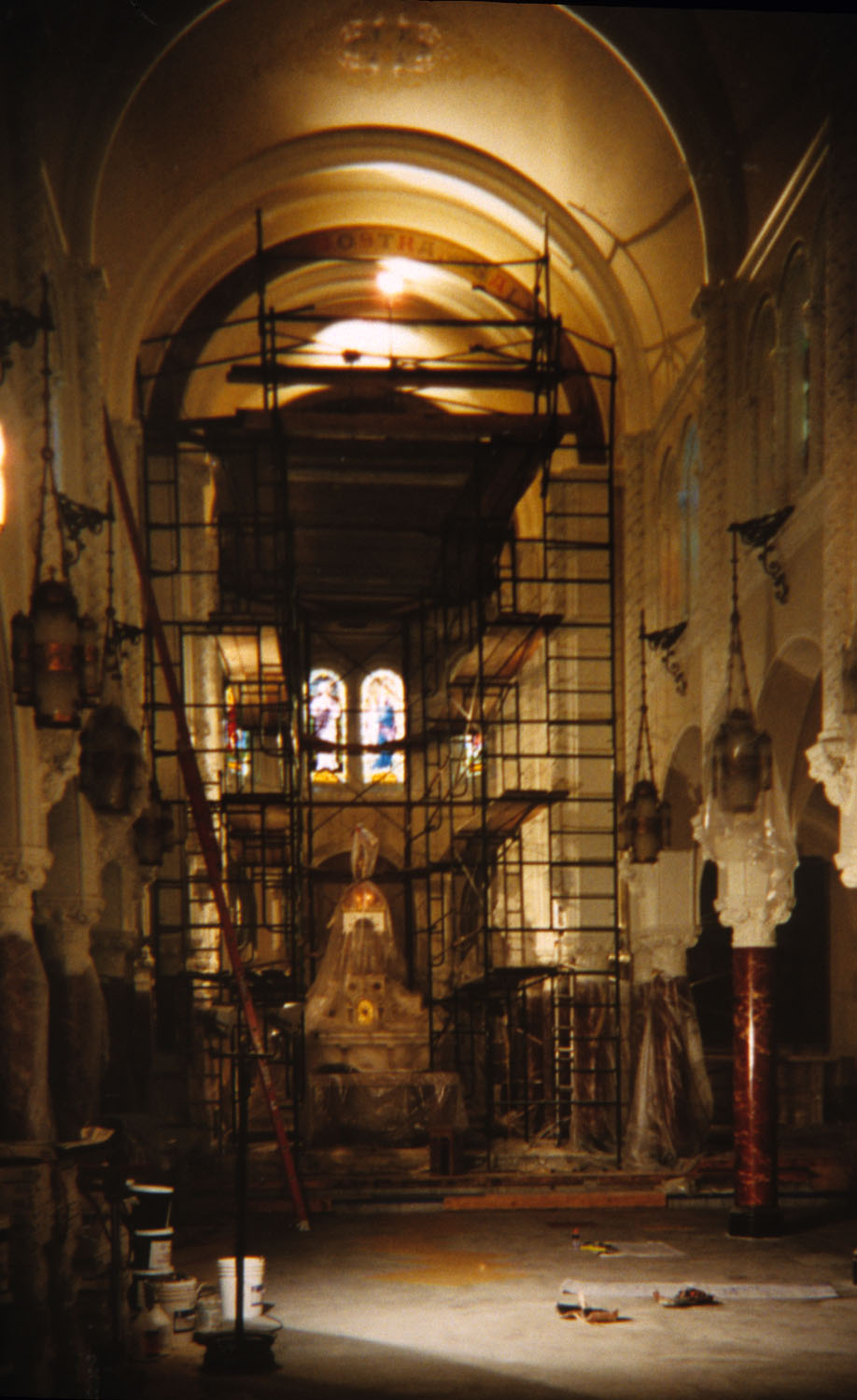 Interior of the nave during construction. The stained glass windows were inspected and catalogued by an objects conservator, then cleaned and repaired by a stained glass specialist. The interior was repainted, including repainting of stencils on the nave ceiling. New flooring and sub-flooring were installed, with restoration and refinishing of the marble floors at the entry and altar.