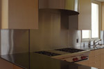 The stainless steel hood was custom fabricated to our design.
