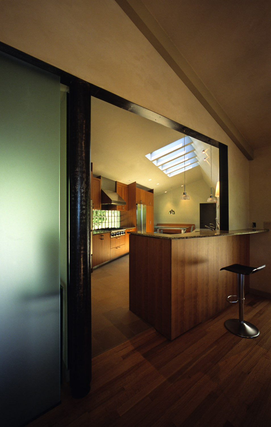The kitchen opens to the dining room, separted by a peninsula bar.