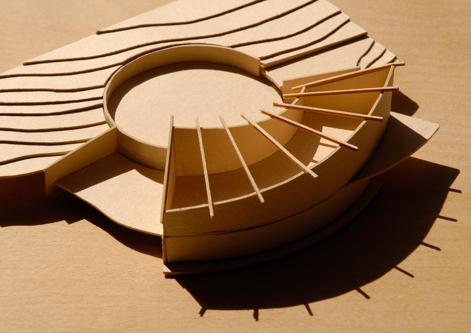 A very early model studying the basic ideas of the design: house shape, roof warp, courtyard and siting.