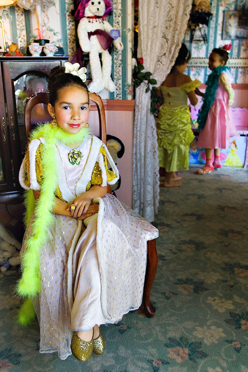 Young girl poses in princess dress