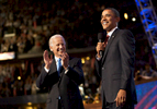 Barack Obama surprises his choice for vice president, Joe Biden, with an appearance on stage at the Democratic National Convention.
