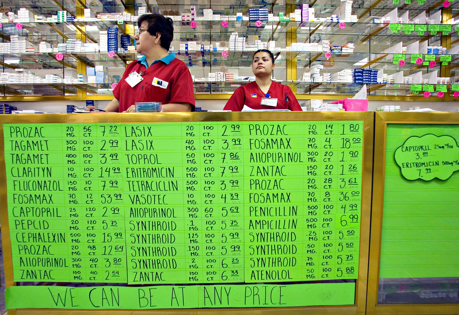 ALGODONES, MEXICO-March 22: Saleswomen wait for customers at one of several branches of Guadalahara Pharmacy March 22, 2005 in Algodones. There are more than a dozen pharmacies in town selling both name brand and generic medications to American customers. (Photo by Radhika Chalasani/Getty Images)