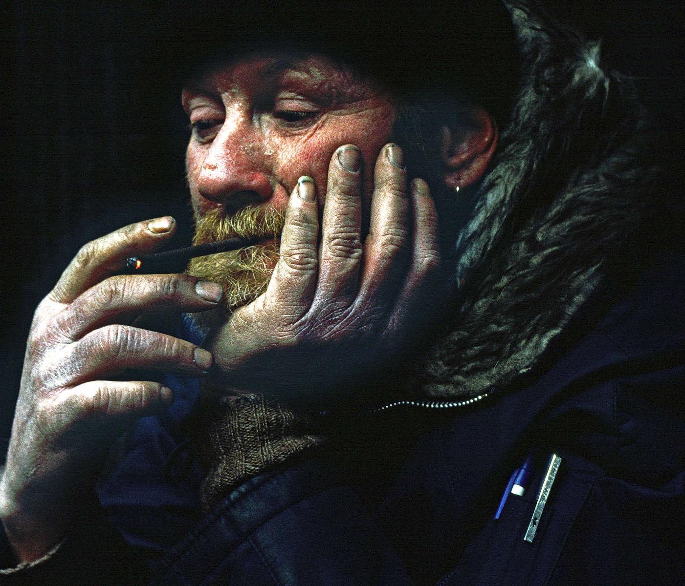 November 2000 -  Homeless man smoking a cigarette.