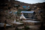 A child runs through Sakhi cemetery in Kabul.