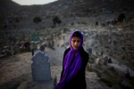 A girl in Sakhi cemetary in Kabul at sunset.