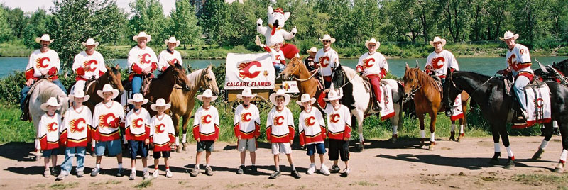 The Calgary Flames contingent along the bank of the Bow River after the Stampede Parade in Calgary.