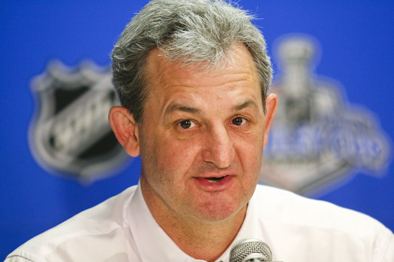 Darryl Sutter addresses the media after a playoff game at the Saddledome in Calgary.