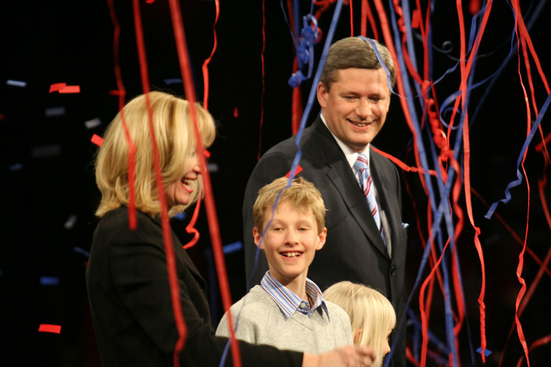 Streamers fall from above as Stephen Harper celebrates with his family after winning a minority conservative government  on election night  in Calgary Alberta.