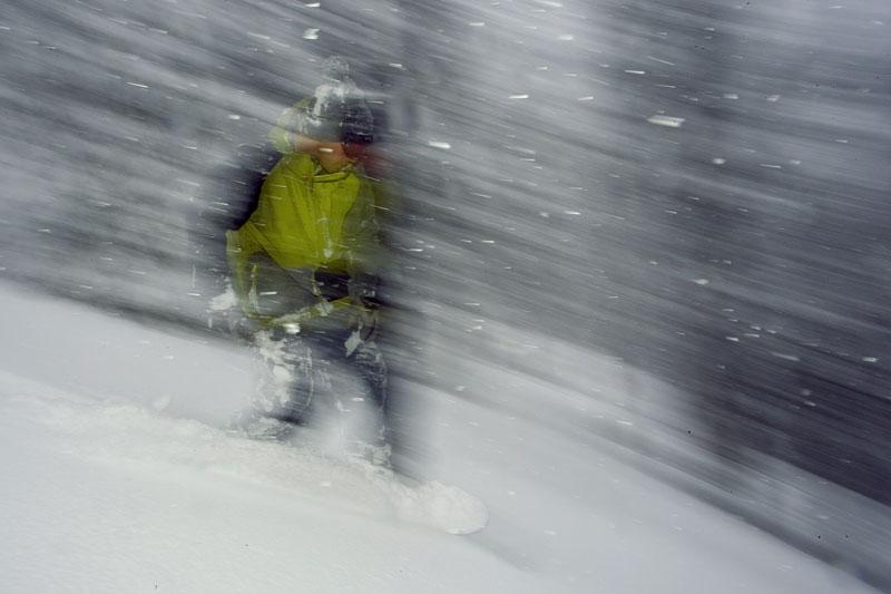 Derek Root rides through heavy snowfall at Island Lake Lodge, Fernie, BC.
